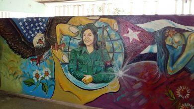 Reaniman pintura mural que representa imagen de Vilma Espín Gillois
